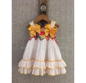 Vestido niña de Nini plumeti amarillo
